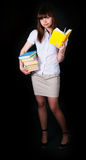 The girl with multi-colored books Stock Photography