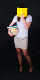 The girl with multi-colored books Stock Photos