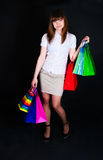 The girl with multi-colored paper packages Royalty Free Stock Photography