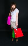 The girl with multi-colored paper packages Stock Photos