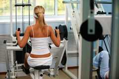 Girl on multi gym Stock Photos
