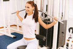 Girl on multi gym. Portrait of beautiful girl working out on multi gym Stock Image