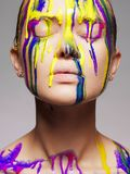 Girl in Multicolor Paint. Colors of woman Royalty Free Stock Photos