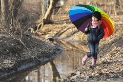 Girl with multicolored umbrella in autumn park Stock Photography
