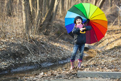 Girl with multicolored umbrella in autumn park Royalty Free Stock Photography