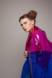 Girl with multicoloured clothing looking angrily Royalty Free Stock Photos