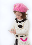 Girl With Multimedia Device Royalty Free Stock Photography