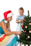 Girl with mum decorates a Christmas tree Royalty Free Stock Photo