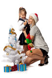 Girl with mum decorates a Christmas tree Royalty Free Stock Photos