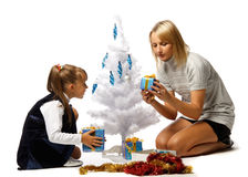 Girl with mum decorates a Christmas tree Stock Image