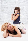 Girl and mum Royalty Free Stock Images