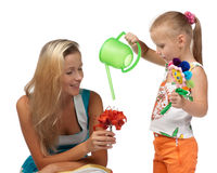 Girl with mum water a flower Royalty Free Stock Photo