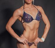 Girl with muscular body Stock Images
