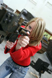 Girl in Museum. Young girl shoots from a old gun Royalty Free Stock Image