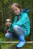Girl with mushroom Royalty Free Stock Photo