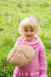 Girl with mushroom Royalty Free Stock Photography