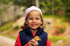 Girl with mushroom Royalty Free Stock Images