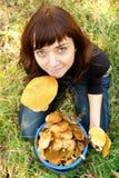 Girl with mushrooms Stock Photos