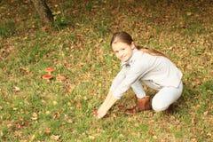 Girl with mushrooms Amanita muscaria Royalty Free Stock Photo