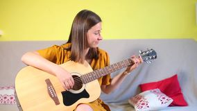 Girl in music school takes acoustic guitar exam. Girl in music school takes an acoustic guitar exam stock video footage