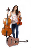 Girl with musical instruments Stock Image