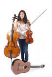 Girl with musical instruments Royalty Free Stock Photo