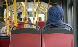 Girl Muslima on bus. Muslim Woman in the Bus, public transportation Royalty Free Stock Photos