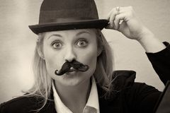 Girl with mustache and bowler hat Stock Image