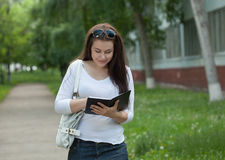 Girl n the campus alley Royalty Free Stock Image