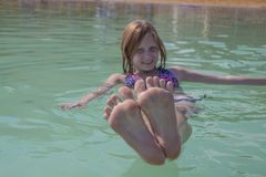 Girl n the Dead Sea, fun picture Royalty Free Stock Images