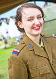 Girl from the NAAFI in World War 1. Portrait of girl from the NAAFI dressed in army uniform seen at 'through the centuries' reenactment at Fort George on 9th and Royalty Free Stock Photos
