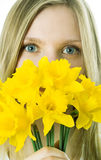 The girl with a narcissus Stock Image