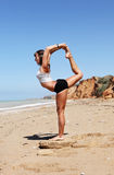 Girl in Nataradzha yoga pose Stock Photo