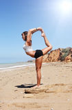 Girl in Nataradzhasana yoga pose Stock Photo