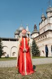 Girl in national closes. Girl in old Russian closes in monastery, Rostov-Velikiy, Russia royalty free stock images