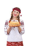 Girl in national costume with crepes. On a white isolated background Stock Photos