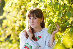 Girl in national costume. In nature Stock Photo