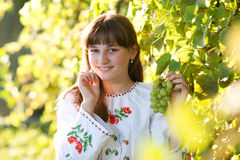 Girl in national costume. In nature Royalty Free Stock Photography