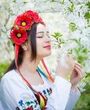 Girl in national dress enjoying spring Stock Images