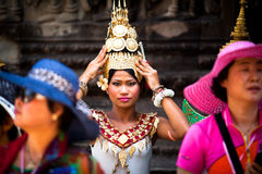 Girl in national dress poses for tourists in Angkor Wat Stock Image