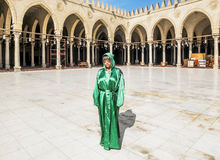 The girl in the national Egyptian attire in the mosque of AMR Ib Royalty Free Stock Image