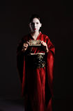 The girl in native costume of japanese geisha. Isolated on black Stock Photography
