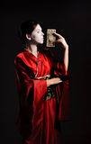The girl in native costume of japanese geisha. Isolated on black Royalty Free Stock Photos
