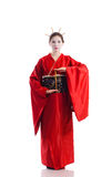 The girl in native costume of japanese geisha. Isolated on white Royalty Free Stock Photo