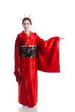 The girl in native costume of japanese geisha. Isolated on white Stock Photos