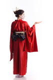 The girl in native costume of japanese geisha. Isolated on white Stock Image