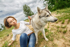 Girl on nature with a dog Stock Photos