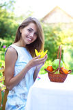 Girl on the nature of fruit Royalty Free Stock Images
