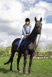 Girl on nature horseback riding on horseback royalty free stock photo