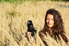 Girl nature photographer waiting in autumn meadow Royalty Free Stock Photography